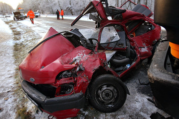 PICTURE SHOWS A CAR AFTER AN ACCIDENT ON AN ICY STREET NEAR HANAU EAST OF FRANKFURT.