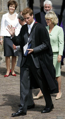 Britain's Prince William waves to well wishers as he departs from his graduation ceremony at St Andrews.