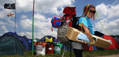 A festival-goer arrives at the Glastonbury festival in south-western England