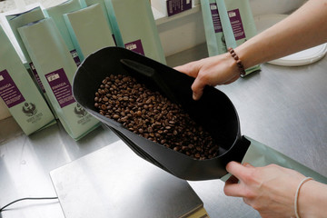 Sandra Dias bags roasted coffee beans for sale at Redeye Coffee Roasters in Hull