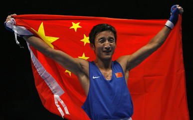 Zou Shiming of China celebrates defeating Harry Tanamor of Philippines during the World Boxing Championships in Chicago