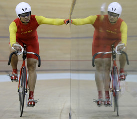 China's Zhang Kuidong rests after losing the Men's Team Sprit (LC1-4 CP3-4) final race against Britain during the Beijing 2008 Paralympic Games