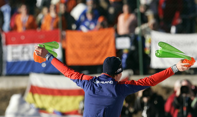 Kramer of the Netherlands celebrates winning the European Speed Skating Championships title at the outdoor Ritten Arena in Collalbo