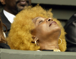 Mother [of Serena and Venus Williams] of the U.S., Oracene, holds her head back during their women's..