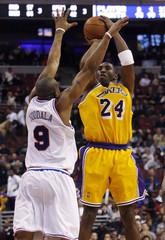 Los Angeles Lakers forward Kobe Bryant shoots over the defense of the Philadelphia 76ers forward Andre Iguodala in Philadelphia Pennsylvania