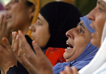 Kashmiri Muslim women offer Friday pray in char-e-sharief, southwest of Srinagar.