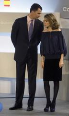Spanish Crown Prince Felipe talks to Spanish Princess Letizia in Madrid
