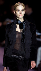 A model for French fashion house Yves Saint Laurent, by American designer Tom Ford, presents this cr..