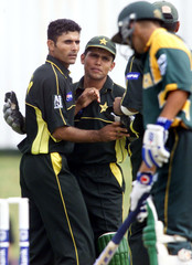 PAKISTAN'S RAZZAQ CELEBRATES THE WICKET AFTER BOWLING S.AFRICA'S GIBBSIN PAARL.