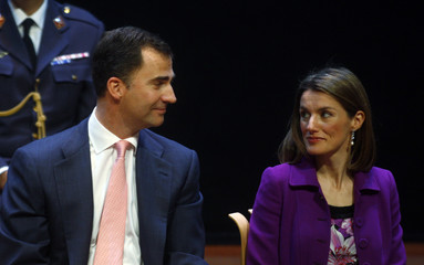 Spain's Prince Felipe and Princess Letizia exchange looks during a seminar at the Guggenheim Museum in Bilbao.