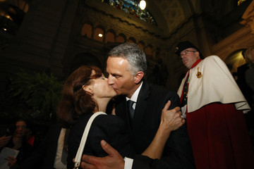 BEST QUALITY AVAILABLE Newly elected Swiss minister Burkhalter kisses his wife Sabine Friedrun during the Autumn Parliament Session in Bern