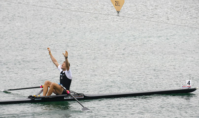 New Zealand's Drysdale reacts after winning in the men's single sculls at the Rowing World Championships in Munich