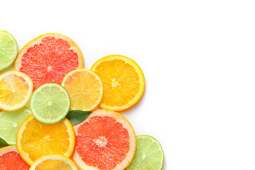Fresh slices of citrus fruits on white background