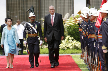 Philippine President Arroyo and Switzerland's President Couchepin review an honour guard upon arrival at the presidential palace in Manila