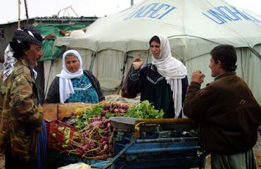 DISPLACED IRAQI KURDS HAGGLE OVER VEGTABLE PRICES IN NORTHERN IRAQ.