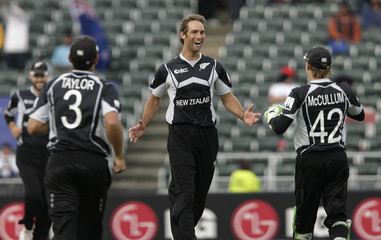 New Zealand's Grant Elliot celebrates taking wicket of Stuart Broad during the ICC Champions Trophy cricket match against England in Johannesburg