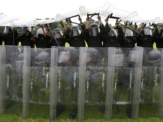 Members of the military's Civil Disturbance Unit conduct an anti-riot drill at the military headquarters in Manila