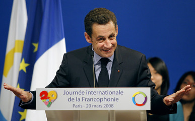 """France's President Nicolas Sarkozy delivers a speech during """"International Francophone Day"""" in Paris"""
