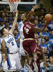 Duke University's McRoberts and Williams stop Florida State's Thornton during their NCAA basketball game in Durham North Carolina
