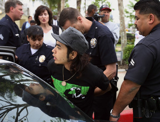 Los Angeles Police officers arrest Jorge Garcia-Alonso for blocking traffic after in Los Angeles