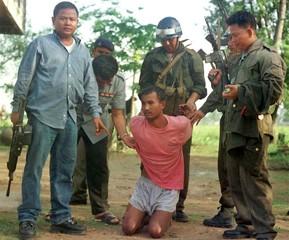 CAMBODIAN POLICE ARREST A SUSPECT AFTER A SHOOTOUT.
