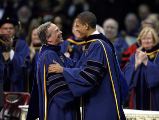 U.S. President Obama is greeted by University of Notre Dame President Jenkins prior to delivering address during commencement ceremonies at the University of Notre Dame in South Bend