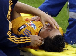 Romania's Radoi receives medical treatment during the Euro 2008 soccer match against Italy in Zurich
