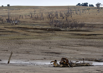 The remains of a truck lie exposed on the site of the old town of Adaminaby as it re-emerges out of Lake Eucumbene
