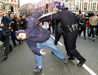 POLICE AND PROTESTER SCUFFLE IN CENTRAL LONDON AS PART OF MAY DAYDEMONSTRATIONS.