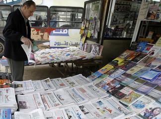 To match feature IRAQ/JOURNALISM