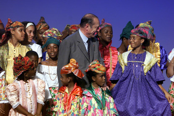 FRENCH PRESIDENT JACQUES CHIRAC POSES WITH GUIANESE SUPPORTERS.