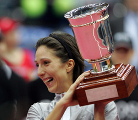 Russia's Myskina lifts the trophy after beating compatriot Dementieva in the Kremlin Cup women's ...