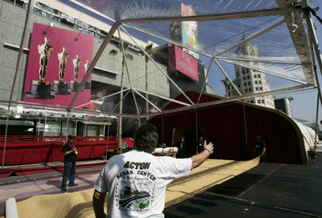 Workers prepare the red carpet outside the Kodak Theater in Los Angeles.