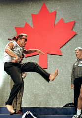 ALBERTA TRESURER STOCKWELL DAY PERFORMS A KARATE KICK AT UNITED ALTERNATIVE CONVENTION.