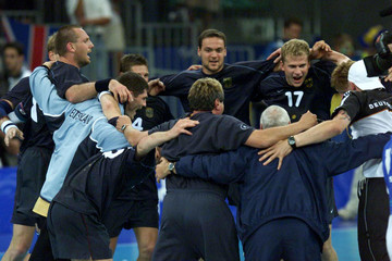 GERMAN HANDBALL TEAM CELEBRATES OLYMPIC VICTORY OVER RUSSIANS.