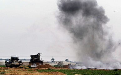SMOKE FROM AN EXPLOSION RISES BESIDE AN ISRAEL ARMY BULLDOZER AND ANAPC AFTER BODIES OF ...