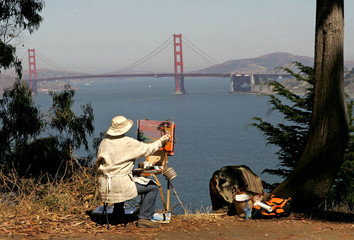 Artist Dominique Caron paints a picture of San Francisco Bay and the Golden Gate Bridge in San Franc..