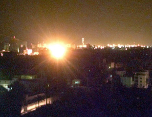 THE SKY OVER GAZA CITY IS ILLUMINATED AS A ROCKET FIRED BY THE ISRAELI ARMY EXPLODES IN THE CITY ...