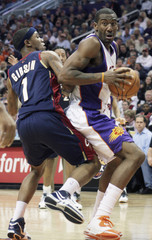 Phoenix Suns Amare Stoudemire is guarded by Cleveland Cavaliers Daniel Gibson in Phoenix