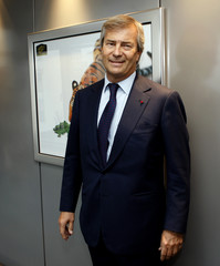 Vincent Bollore, Chairman and main shareholder of French advertising group Havas arrives at a news conference in Suresnes