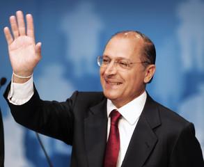 Opposition presidential candidate Geraldo Alckmin waves before a television debate with Brazil's President Luiz Inacio Lula da Silva in Sao Paulo