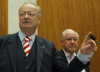 Conservatives' (OeVP) Seniorenbund president Khol checks the microphone at an assembly of Austrian retirees associations (Seniorenrat) in the parliament in Vienna