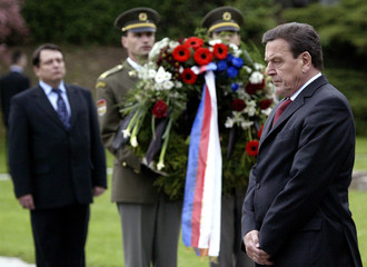 German Chancellor Gerhard Schroeder and Czech Republic's Prime Minister Paroubek stand in Terezin.