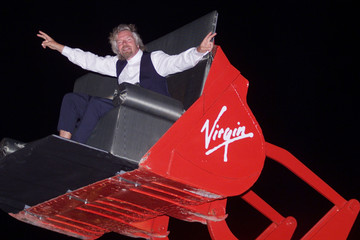 Dressed in traditional Lebanese villager clothes and sitting in an earth mover Sir Richard Branson m..
