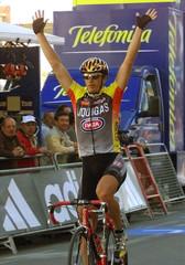 ITALIAN CYCLIST ZANOTTI RAISES HIS ARMS AS CROSSES THE FINISH LINE.