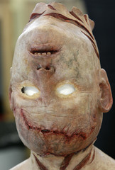 A latex mask sits on a stand in the makeup room on the set of the horror movie 'Dark Floors' in Oulu