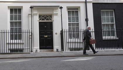 Britain's Chancellor of the Exchequer Alistair Darling holds Gladstone's old Budget box for the cameras outside 11 Downing Street in London