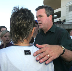Florida Gov Jeb Bush listens to concerns from Pensacola shelter residents.