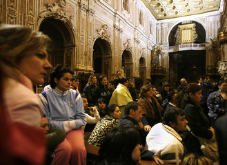 Parents attend a meeting at night during the occupation of the Basilica del Carmine in Naples