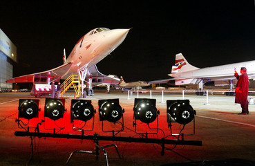 An admirer takes photographs of the last British Airways Concordes as they stand on the tarmac at Lo..